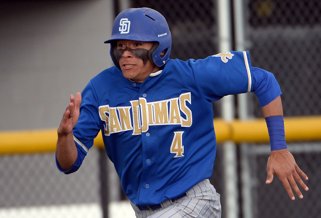 . San Dimas\' Jeremy Marquez scores on a double by San Dimas\' David Vargas (not pictured) in the sixth inning of a prep baseball game at Northview High School in Covina, Calif., on Wednesday, March 26, 2014. San Dimas won 2-0. (Keith Birmingham Pasadena Star-News)