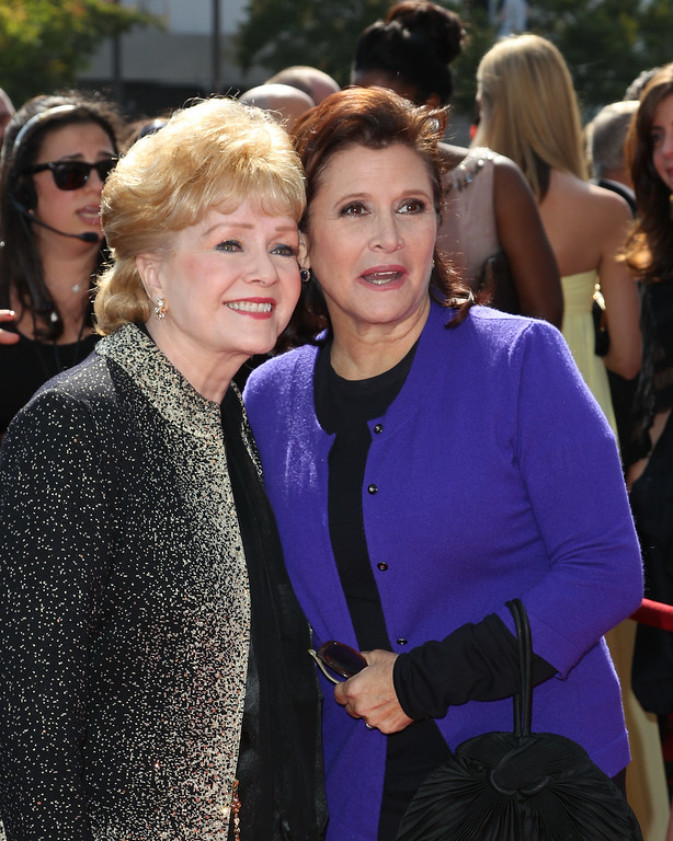 . Debbie Reynolds (L) and Carrie Fisher attends the 2011 Primetime Creative Arts Emmy Awards at Nokia Theatre on September 10, 2011 in Los Angeles, California.  (Photo by Noel Vasquez/Getty Images)