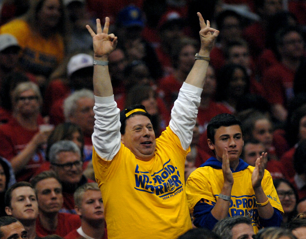 . Warriors fans celebrate a three-pointer by Klay Thompson in the first quarter of game seven of the Western Conference playoffs, Saturday, May 3, 2014, at Staples Center. (Photo by Michael Owen Baker/L.A. Daily News)
