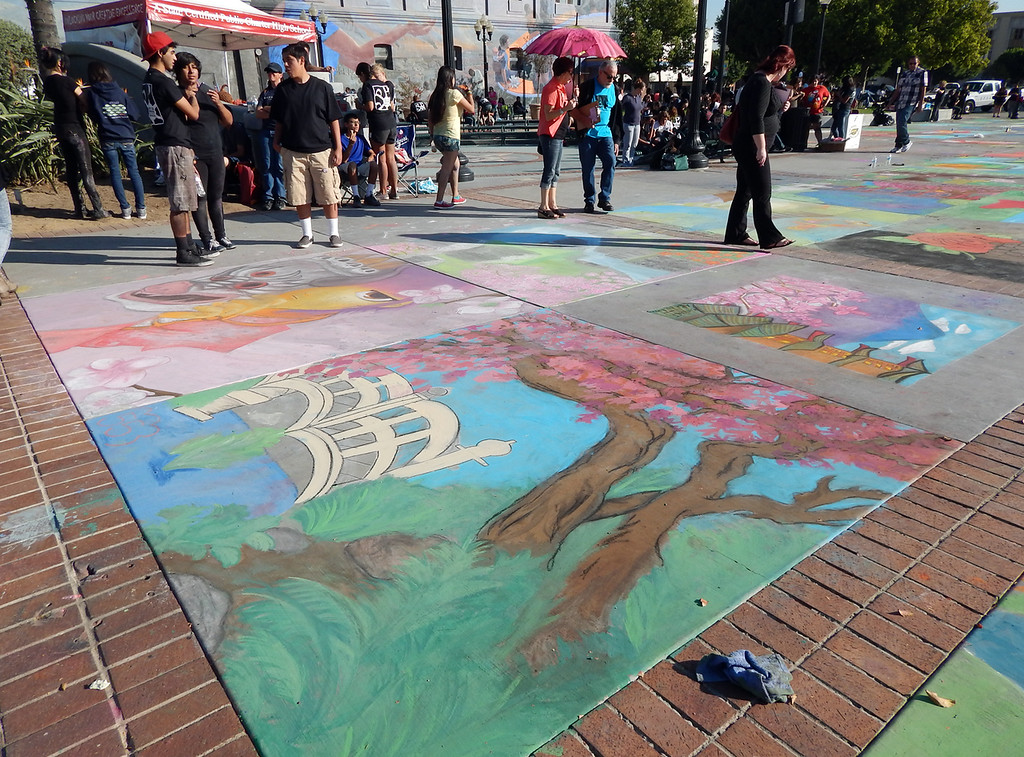 . The annual Chalk Art Festival was a success. About 200 middle and high school kids were expected to participate and about 400 showed up. Many students chose to create art that followed the �Japanese Garden� theme but others tried to create pieces inspired by this year�s Together We Read title, �Farewell to Manzanar.�  (Photo by Monica Rodriguez/Inland Valley Daily Bulletin)