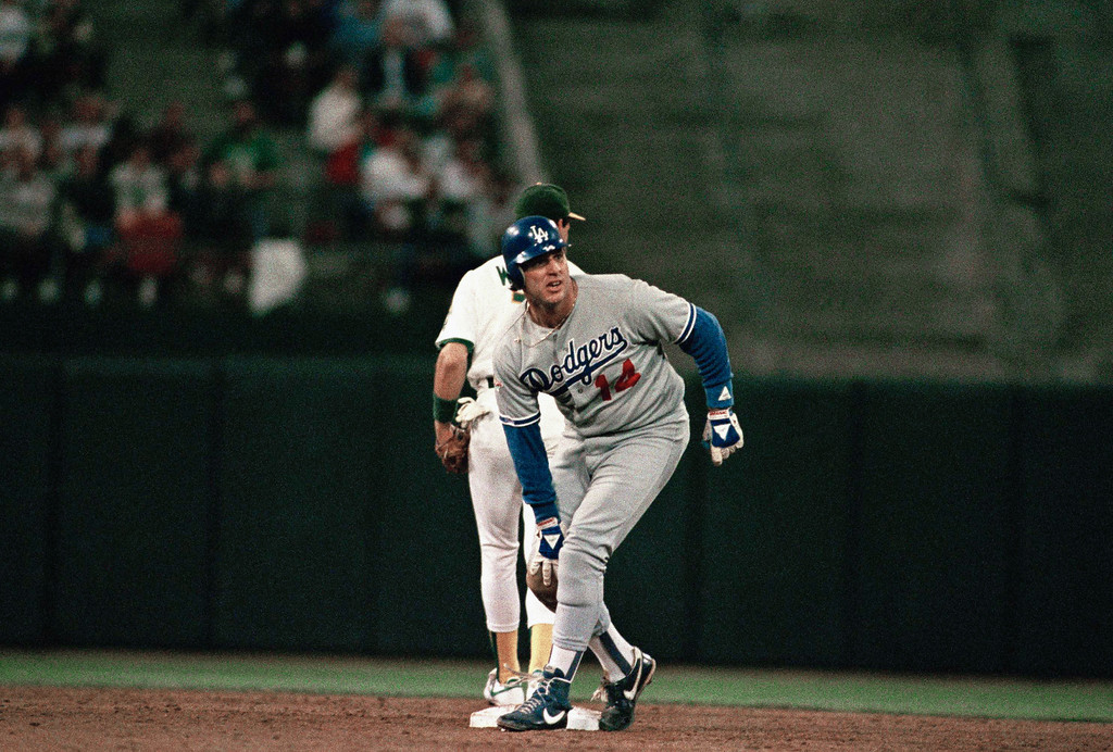 . Los Angeles Dodgers catcher Mike Scioscia reacts after injuring himself sliding into second base on a failed hit and run play in the fourth inning of the fourth game of the World Series against the Oakland A\'s at Oakland Coliseum, Wednesday, Oct. 19, 1988 in Oakland. In the background is Oakland A\'s shortstop Walt Weiss who made the putout. (AP Photo/Eric Risberg)