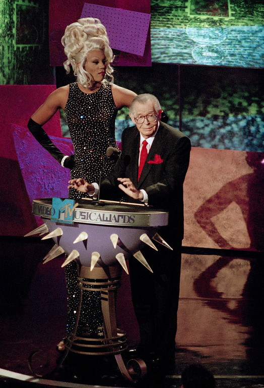 . Transvestite entertainer RuPaul towers over the legendary Milton Berle as they prepare to present the Viewers Choice Video Award category during the MTV Music Video Awards at the Universal Amphitheatre at Universal City. Calif., Thursday, Sept. 2, 1993. (AP Photo/Kevork Djansezian)