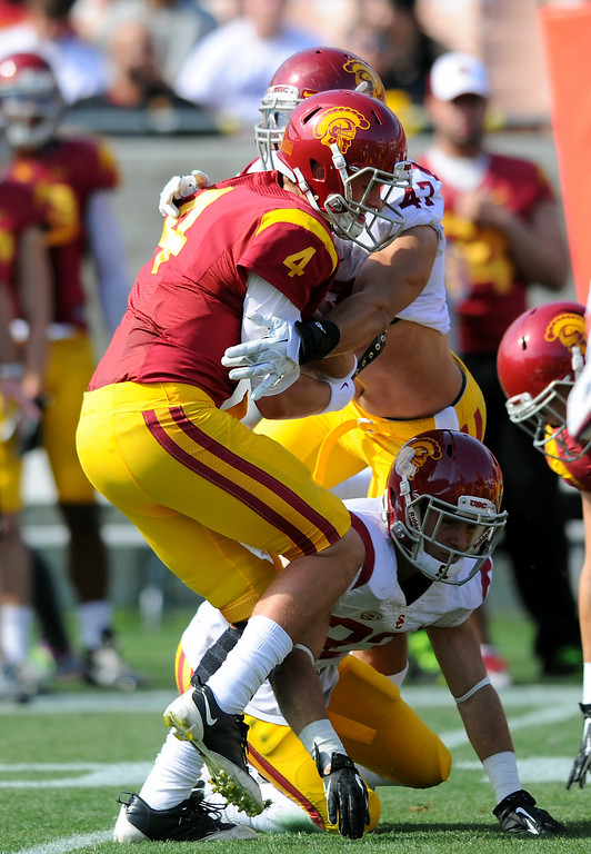 . USC QB Max Brown is sacked by LB Scott Starr during their spring game, Saturday, April 19, 2014, at the Coliseum. (Photo by Michael Owen Baker/L.A. Daily News)