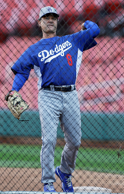 . Los Angeles Dodgers manager Don Mattingly throws batting practice before Game 1 of the National League baseball championship series against the St. Louis Cardinals Friday, Oct. 11, 2013, in St. Louis. (AP Photo/Jeff Roberson)
