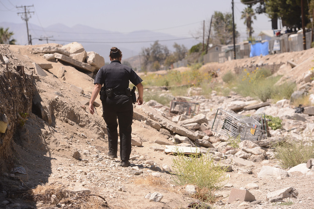 . San Bernardino Police Officer and Homeless Advocate Sochilt Martinez leaves a homeless camp located in the wash underneath 40th Street in San Bernardino August 14, 2013.  GABREL LUIS ACOSTA/STAFF PHOTOGRAPHER.