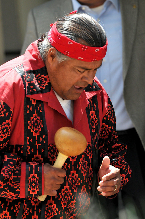 . (John Valenzuela/Staff Photographer)  Serrano-Cahuilla Elder Kim Marcus perform Serrano-Cahuilla songs during the dedication cermony of the renovated Barton School House at The Grove School in Redlands, May 24, 2013.