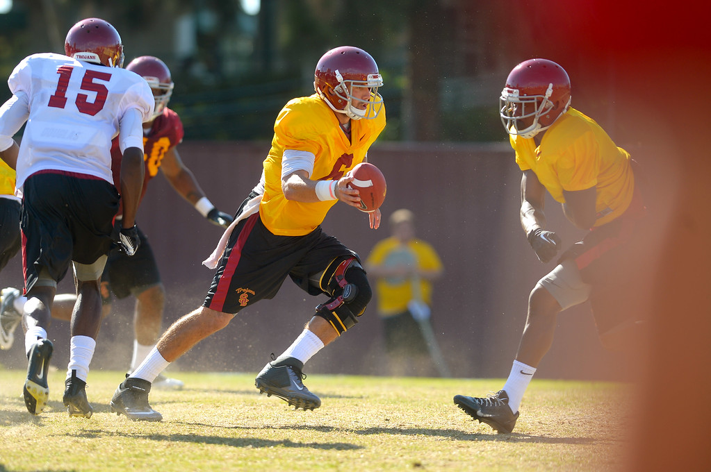 . Quarterback Cody Kessler runs a play during a USC practice August 20, 2013.(Andy Holzman/Los Angeles Daily News)