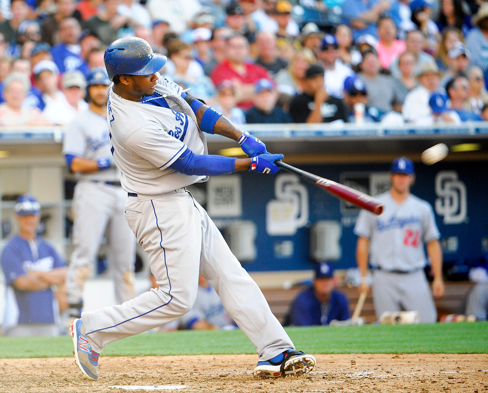 . Hanley Ramirez #13 of the Los Angeles Dodgers hits solo home run during the seventh inning of a baseball game against the San Diego Padres at Petco Park on June 22, 2013 in San Diego, California.  Dodgers won 6-1.   (Photo by Denis Poroy/Getty Images)
