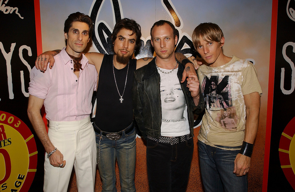 ". NEW YORK - JULY 22: The band Janes Addiction attends a CD signing of their new release ""Strays\"" at Tower Records in New York City,  July 22, 2003. From left to right are singer Perry Farrell, guitarist Dave Navarro, drummer Stephen Perkins, and bassist Chris Chaney. (Photo by Frank Micelotta/Getty Images for Capitol Records )"