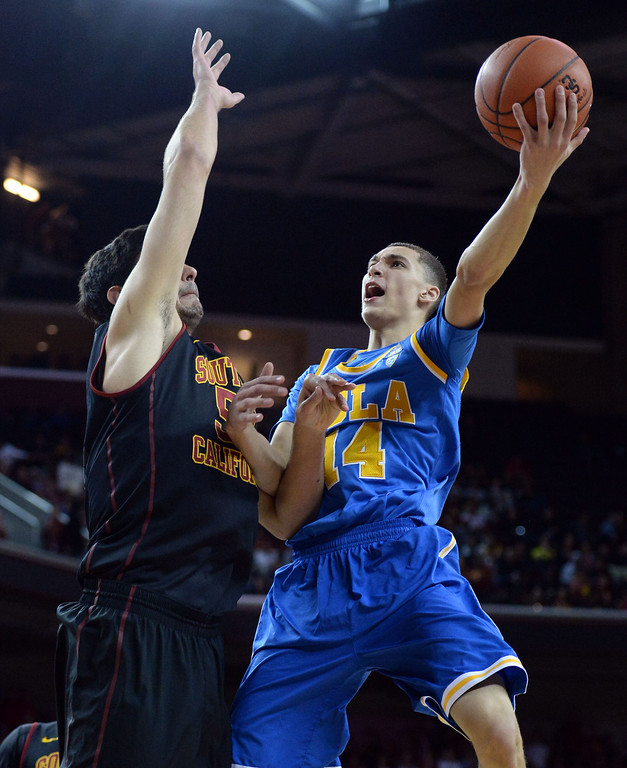 . UCLA\'s Zach LaVine (14) drives to the basket against Southern California\'s Omar Oraby (55) in the first half of a PAC-12 NCAA basketball game at Galen Center in Los Angeles, Calif., on Saturday, Feb. 8, 2014. (Keith Birmingham Pasadena Star-News)