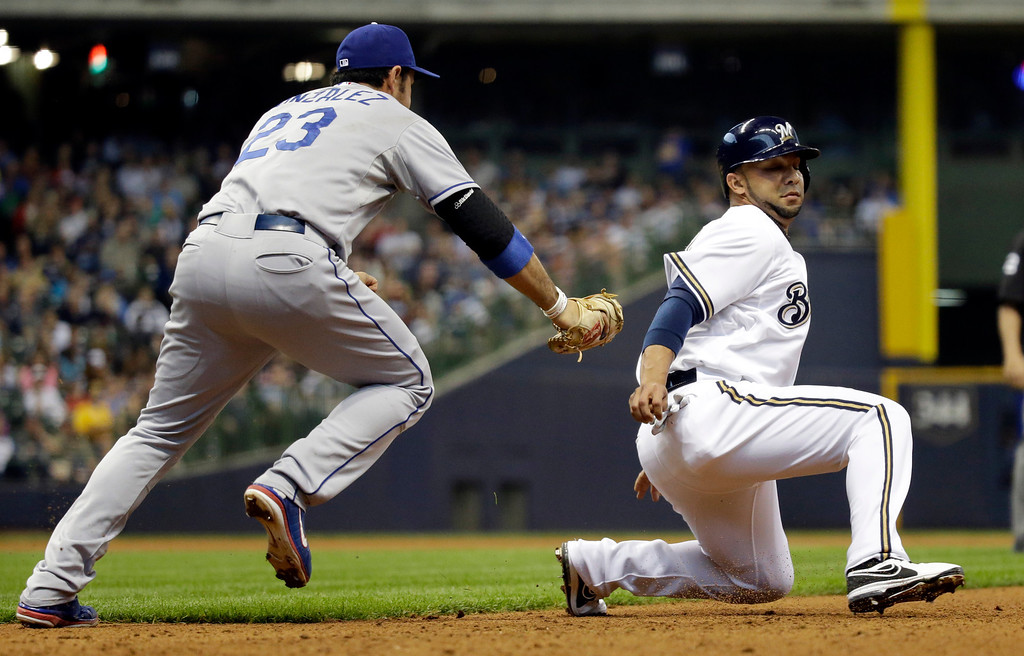 . Los Angeles Dodgers\' Adrian Gonzalez (23) tags out Milwaukee Brewers\' Alex Gonzalez after he was caught in a rundown during the fifth inning of a baseball game Wednesday, May 22, 2013, in Milwaukee. (AP Photo/Morry Gash)