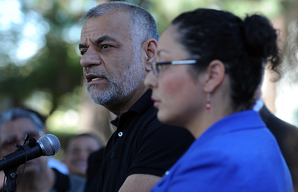 . City of South Gate mayor, Gil Hurtado, left, with assembly member Cristina Garcia (D-Bell Gardens) speaks during a press conference calling for Senator Ron Calderon to resign his position in the California State Senate in front of the Bell Gardens City Hall in Bell Gardens , Calif., on Wednesday, Nov. 13, 2013.