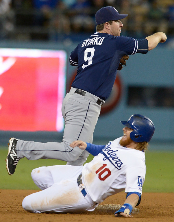 . Padres Jedd Gyorko catches Justin Turner in a double play in the 7th. The Dodgers lost to the San Diego Padres 4-1 at Dodger Stadium. Los Angeles, CA. 8/20/2014(Photo by John McCoy Daily News)
