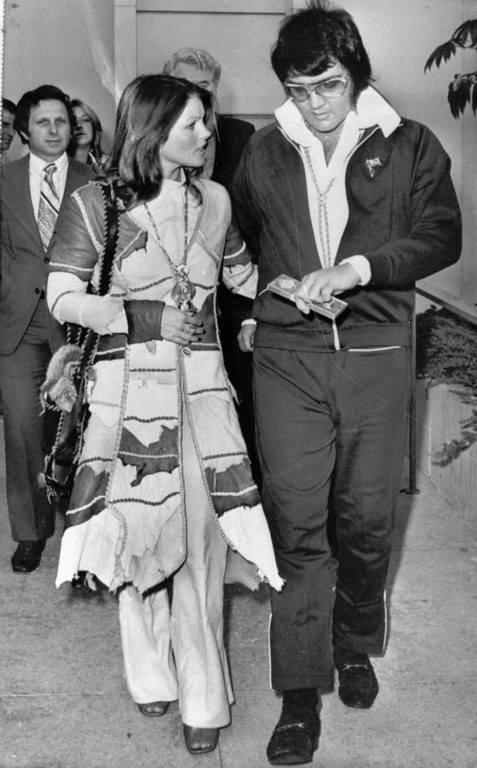 . Singer Elvis Presley and wife, Priscilla, 26, leave Superior Court in Santa Monica, Calif. on Oct.10,1973 after he was granted a divorce on grounds of irreconciliable difference. The six year marriage ended with a modified property settlement involving $1.5 million. (AP Photo/tms)