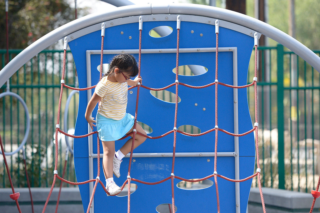 . Isabel Valdivia,5, climbs on a structure at Fulton Ave. Park , located on Fulton Avenue north of Vanowen. A new Park Score survey done by the Trust For Public Land that ranks LA 45th out of 60 cities in the country in terms of parks, accessibility, maintenance and acreage. North Hollywood. CA. 5/29/2014(Photo by John McCoy / Los Angeles Daily News)