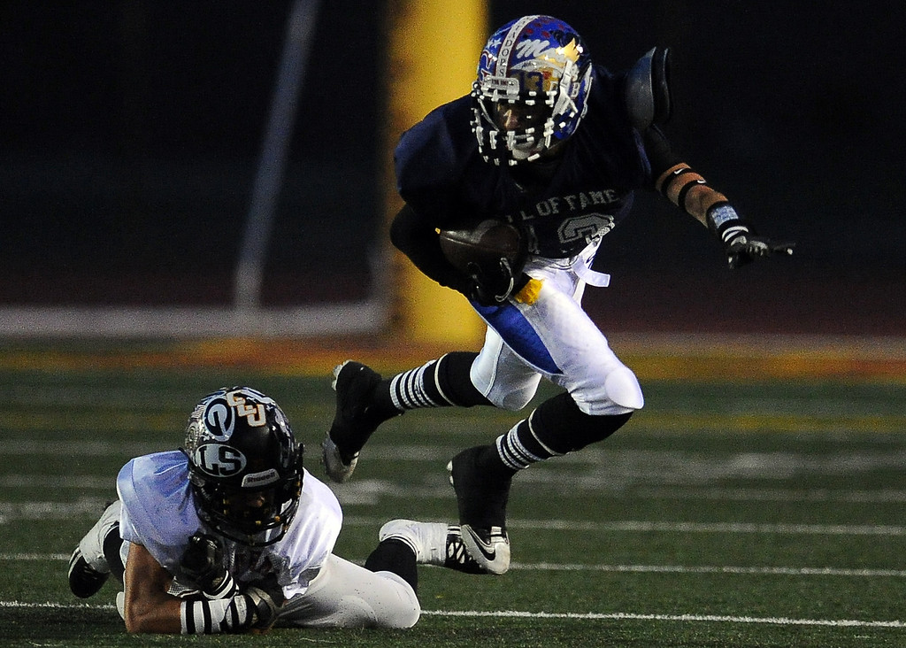 . West\'s Gabriel Larios (San Gabriel) catches a pass for a first down in the first half of the annual East vs. West San Gabriel Valley Hall of Fame all-star football game at West Covina High School on Friday, May 17, 2013 in West Covina, Calif.  (Keith Birmingham Pasadena Star-News)