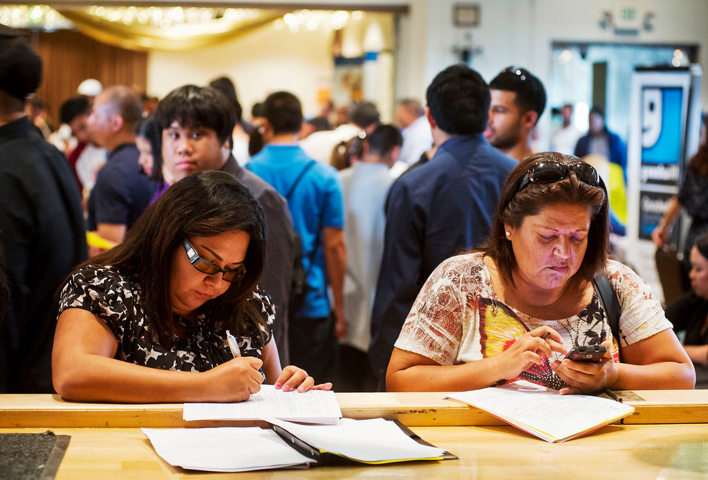 . Job seekers fill out their applications during the El Monte Job Fair, one of the largest job fairs in the San Gabriel Valley, at the El Monte Community Center on Friday, June 21, 2013. Over the last 12 months California\'s economy added 252,100 jobs, a growth rate of 1.8 percent. (SGVN/Staff photo by Watchara Phomicinda)