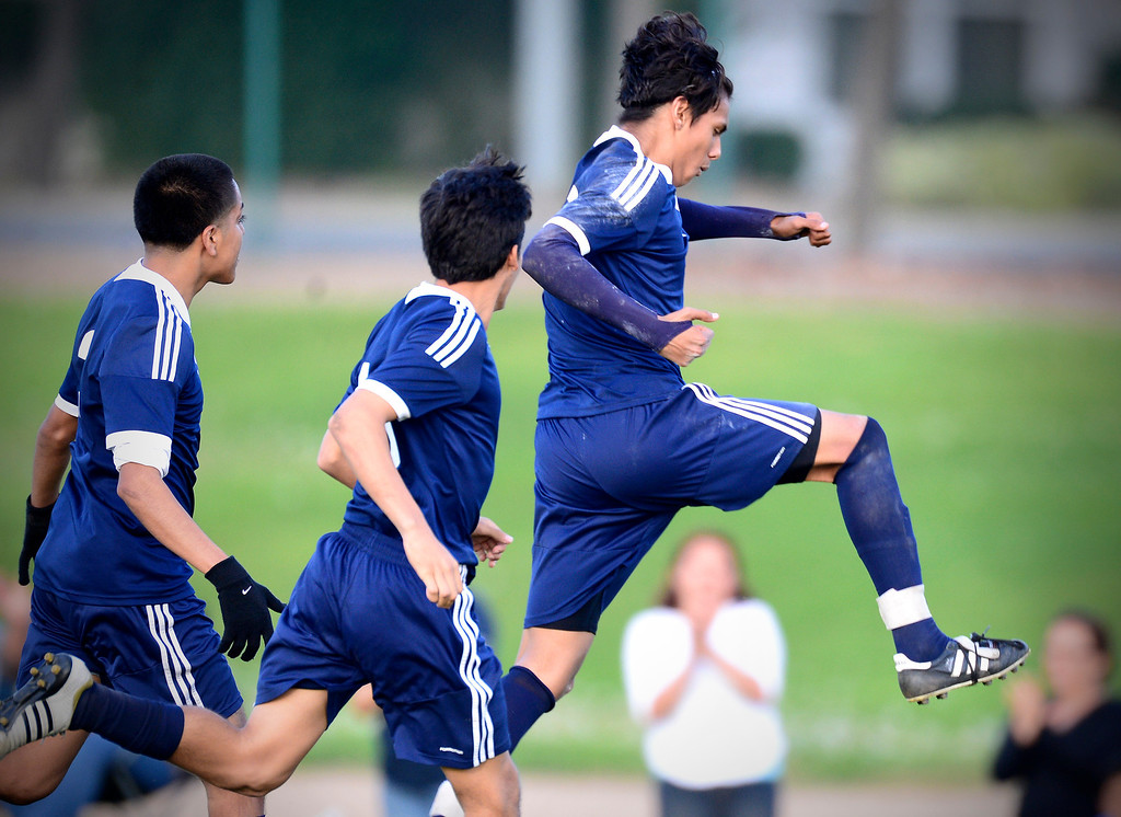 . Baldwin Park\'s Danny Vega (20) celebrates his first goal of the game as they defeat Northview 2-0 during Tuesday\'s game at Northview High School, February 11, 2014. Vega has made 31 goals this season. (Photo by Sarah Reingewirtz/Pasadena Star-News)