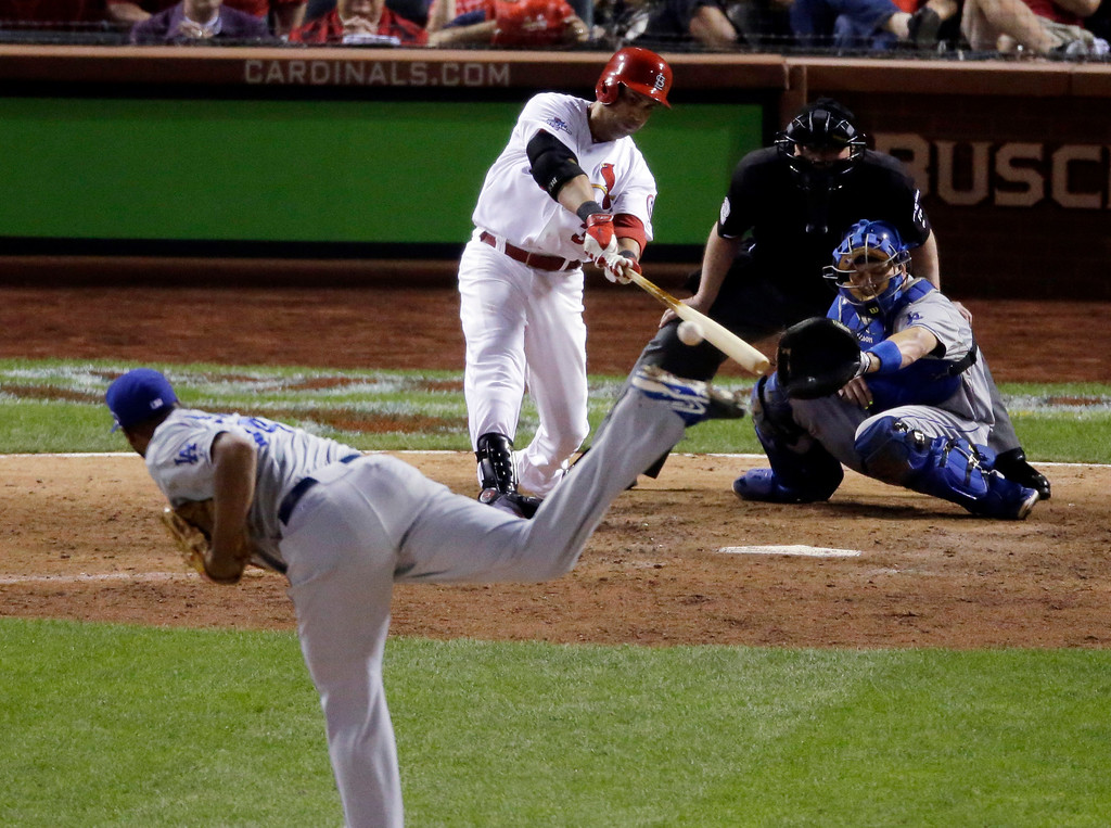 . St. Louis Cardinals\' Carlos Beltran hits his game-winning hit during the 13th inning of Game 1 of the National League baseball championship series against the Los Angeles Dodgers Saturday, Oct. 12, 2013, in St. Louis. (AP Photo/Chris Carlson)