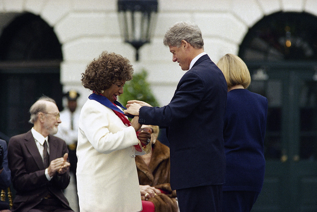 . President Bill Clinton presents salsa singer, Cuban-born Celia Cruz of New York, with a 1994 National Medal of Arts at the White House in Washington, Oct. 14, 1994. The president honored 12 Americans and one organization for their contributions to the nation�s culture. (AP Photo/Joe Marquette)