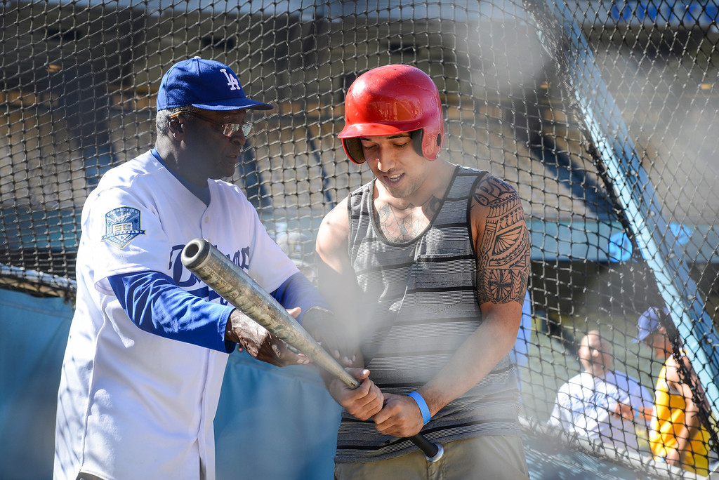 . The Dodger\'s Lou Johnson helps Milton Peko of San Bernardino with his swing on Veterans Day at Dodger Stadium Monday, November 11, 2013.  The dodgers hosted 100 active duty and retired military to Dodger Stadium to take part in batting practice, enjoy and Dodger lunch and tour the facilities.    ( Photo by David Crane/Los Angeles Daily News )