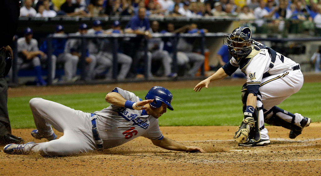 . Milwaukee Brewers catcher Jonathan Lucroy, right, tags out Los Angeles Dodgers\' Andre Ethier (16) at home during the fifth inning of a baseball game Tuesday, May 21, 2013, in Milwaukee. (AP Photo/Morry Gash)