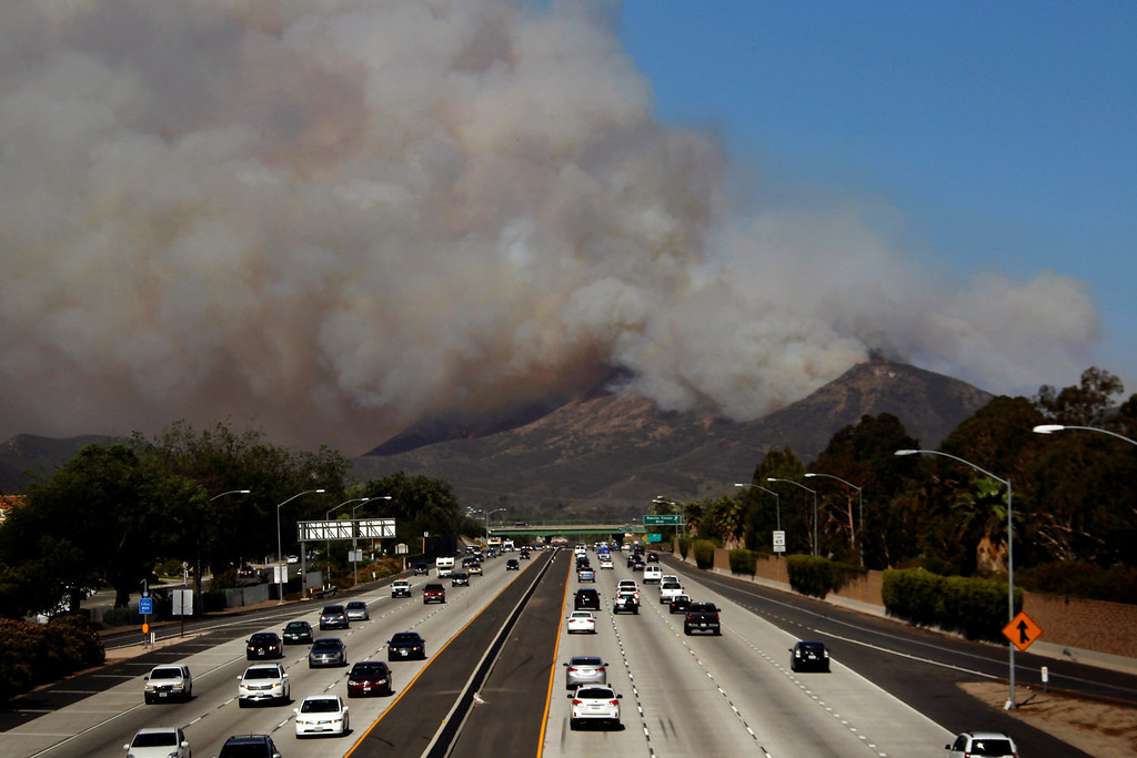 . Smoke billows over along U.S. 101 near Thousand Oaks, Calif. on Thursday, May 2, 2013.  Authorities have ordered evacuations of a neighborhood and a university about 50 miles west of Los Angeles where a wildfire is raging close to subdivisions. The blaze on the fringes of Camarillo and Thousand Oaks broke out Thursday morning and was quickly spread by gusty Santa Ana winds. Evacuation orders include California State University, Channel Islands. (AP Photo/Nick Ut)