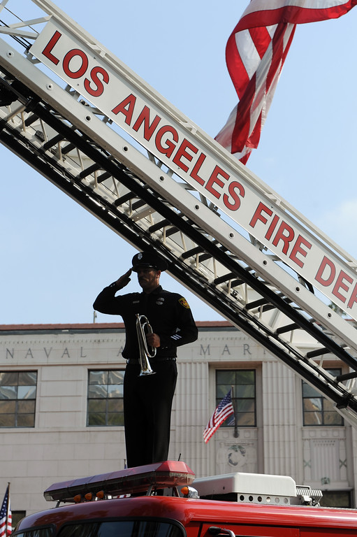 . LAFD firefighter Dustin Clark salutes at the 9/11 Remembrance Ceremony at the World Trade Center Memorial at LAFD Frank Hotchkin Memorial Training Center, Thursday, September 11, 2013. (Photo by Michael Owen Baker/L.A. Daily News)