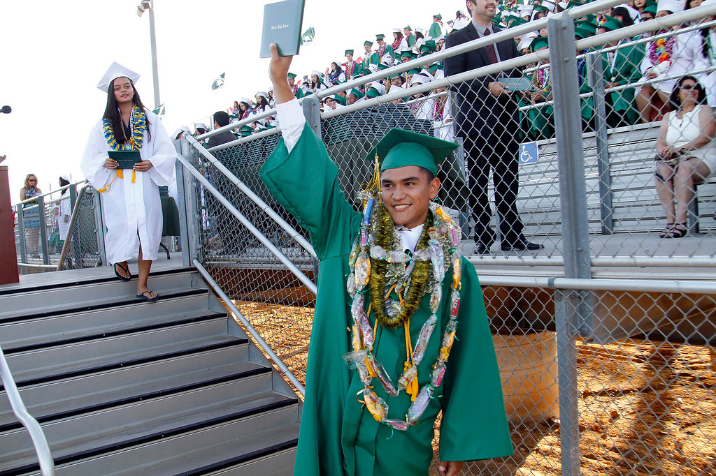 ". Alex Aguilar receives his diploma in ""Highest Honors,\"" during Schurr High School 2013 Commencement Exercises, at Ken Davis Field, at Schurr High School in Montebello, Thursday, June 20, 2013. (Correspondent Photo by James Carbone/SWCITY)"