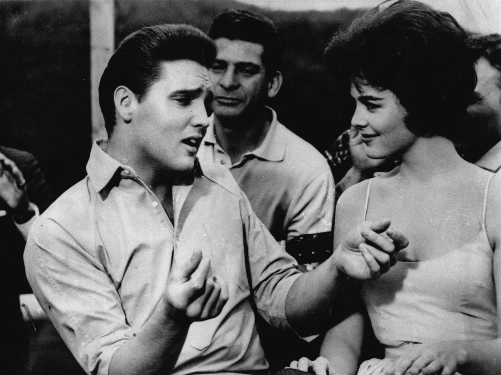 ". Elvis Presley, left, appears in a scene from the movie, ""Kid Galahad\"".  (AP Photo)"