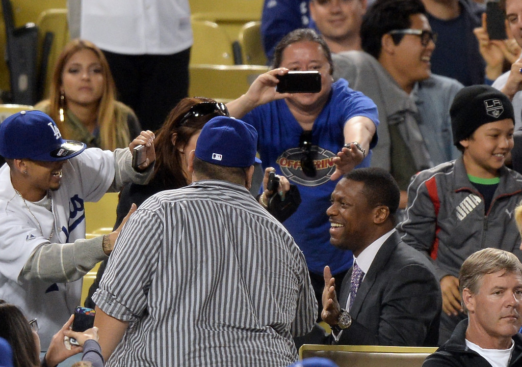 . Actor Chris Tucker makes his way through a crowd between inning during the game between the Colorado Rockies and the Los Angeles Dodgers at Dodger Stadium on May 1, 2013 in Los Angeles, California.  (Photo by Harry How/Getty Images)