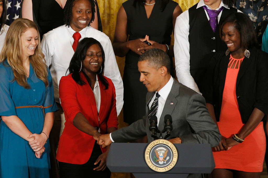 . Point guard Odyssey Sims gets a fist bump from President Barack Obama at a ceremony honoring the 2012 NCAA Women\'s basketball champions Baylor University Bears in the East Room at the White House in Washington, Wednesday, July 18, 2012. (AP Photo/Charles Dharapak)