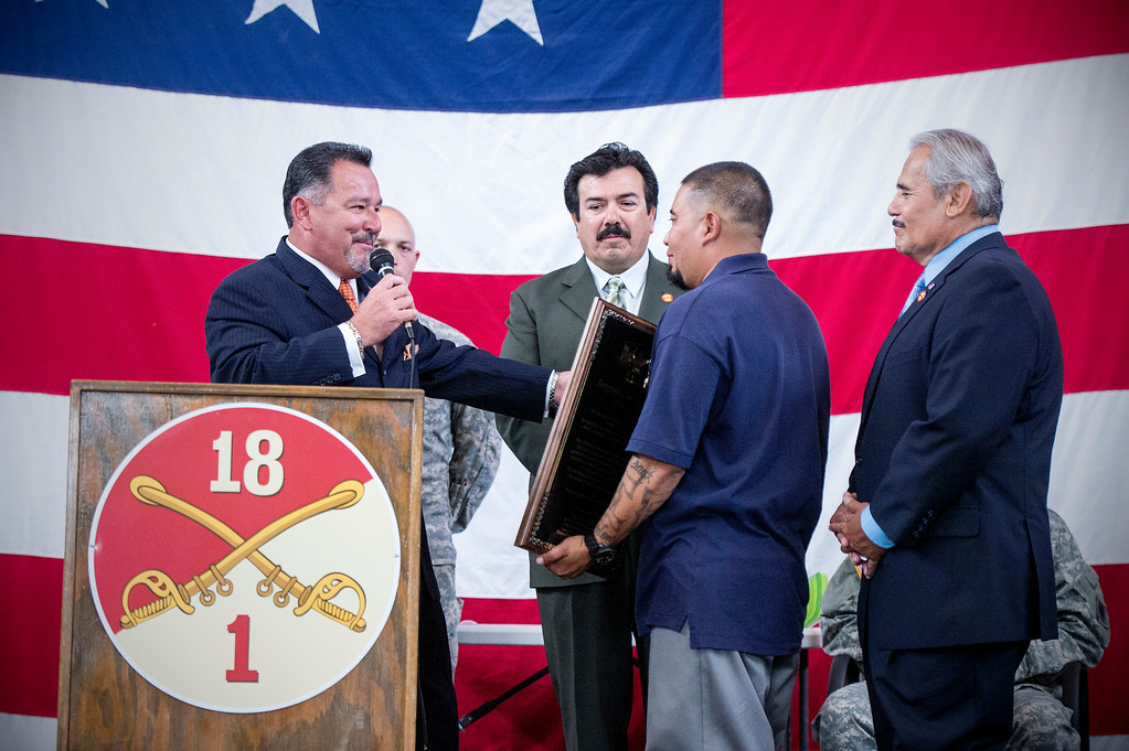 . Irwindale officials give an award to Sgt. Luis Bardales, a resident of Irwindale who works for the city of South Pasadena, after he received a Purple Heart at the Army National Guard in Azusa Saturday, July 12, 2014. Bardales was wounded by a roadside IED in Baghdad, Iraq and saved gunner Gabriel Herrera by pulling him out of their Humvee before another IED explosion. (Photo by Sarah Reingewirtz/Pasadena Star-News)