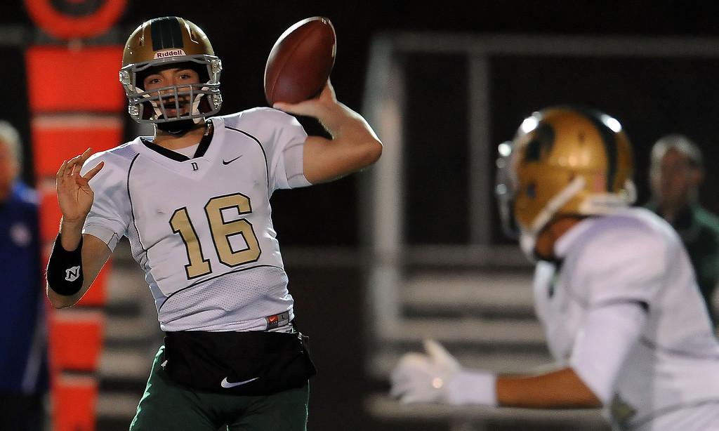 . Damien quarterback Brendan Callen (16) passes in the first half of a prep football game against Charter Oak at Charter Oak High School in Covina, Calif., Friday, Oct. 11, 2013.    (Keith Birmingham Pasadena Star-News)