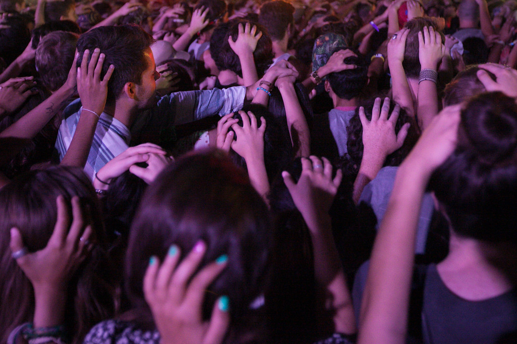 . Fans follow the instructions of Dan Deacon and put their hands on their neighbor\'s head at FYF Fest in downtown L.A., Saturday, August 24, 2013. (Michael Owen Baker/L.A. Daily News)