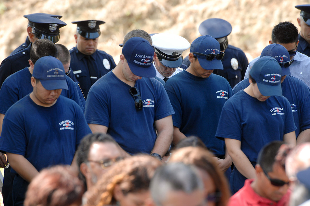 . Fire personnel bow their heads during the 9/11 Remembrance Ceremony at the World Trade Center Memorial at LAFD Frank Hotchkin Memorial Training Center, Thursday, September 11, 2013. (Photo by Michael Owen Baker/L.A. Daily News)
