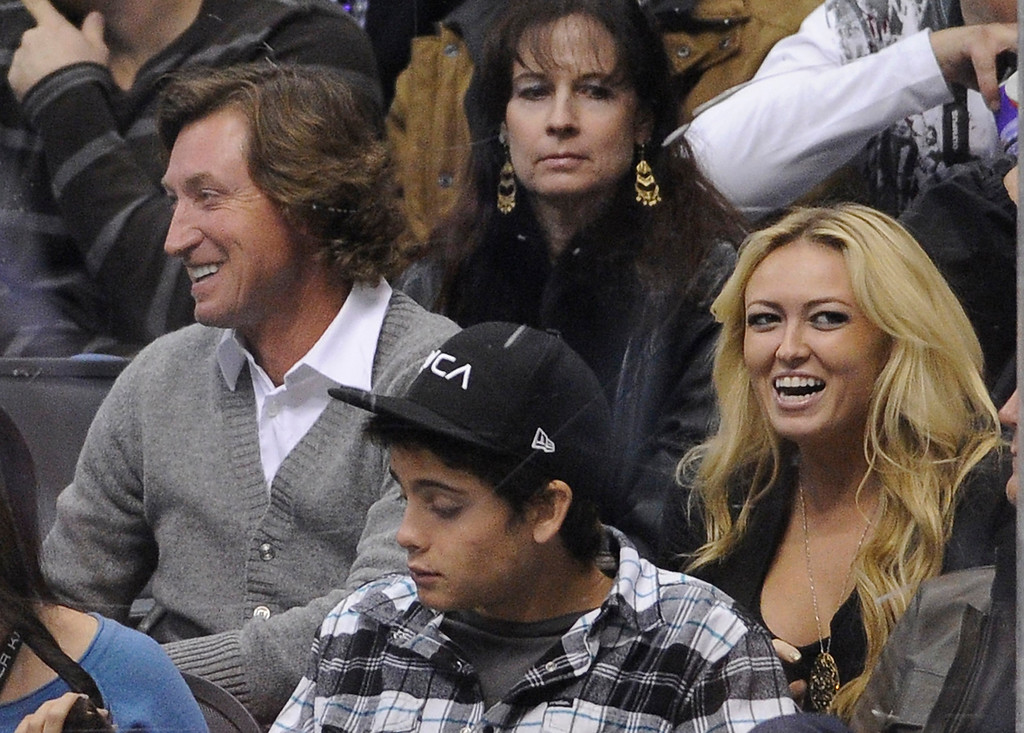 . Hockey great Wayne Gretzky sits with his wife Janet Jones watch the Detroit Red Wings play the Los Angeles Kings during the third period of their NHL hockey game, Saturday, Dec. 4, 2010, in Los Angeles. The Kings won 3-2. (AP Photo/Mark J. Terrill)