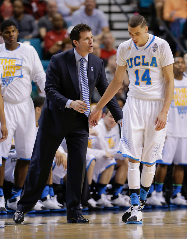 . UCLA coach Steve Alford, left, talks with Zach LaVine in the second half of an NCAA Pac-12 conference tournament quarterfinal college basketball game against Oregon, Thursday, March 13, 2014, in Las Vegas. (AP Photo/Julie Jacobson)
