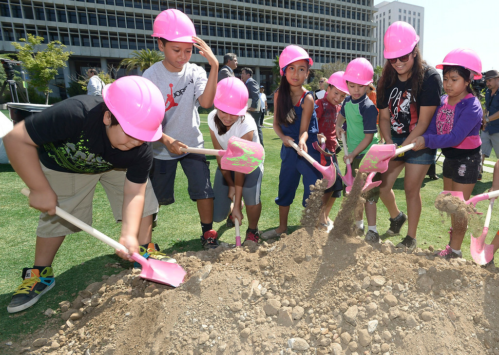 . Children from Casa Cultura Saybrook Park in Los Angeles break ground for the Park�s innovative new play area.  The play area is slated to open in November 2014.  Los Angeles, CA. 7/30/2014(Photo by John McCoy Daily News)
