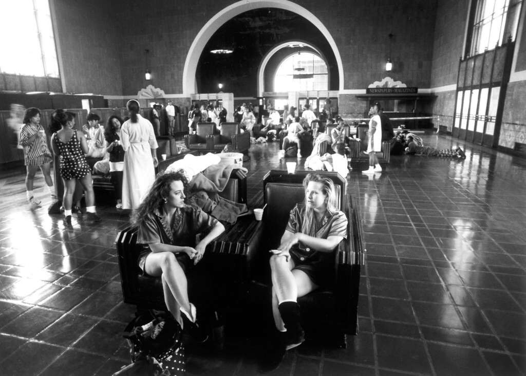 """. In the waiting area, with double chairs, actresses Victoria Fleming, left, and Mary Johnson wait to film their scene in \""""House Party 2\"""" on April 30, 1991.    (Los Angeles Daily News file photo)"""