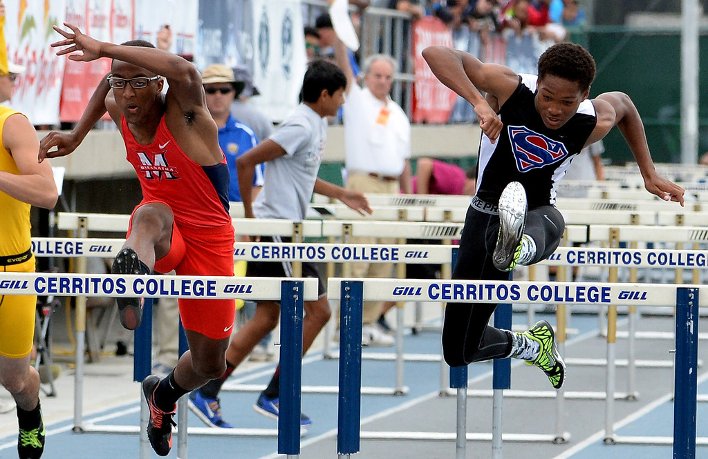 . Maranatha\'s Baron Burems, left, along with Serra\'s Zinovian Cannady competes in the division 4 110 meter high hurdles during the CIF Southern Section track and final Championships at Cerritos College in Norwalk, Calif., Saturday, May 24, 2014. 