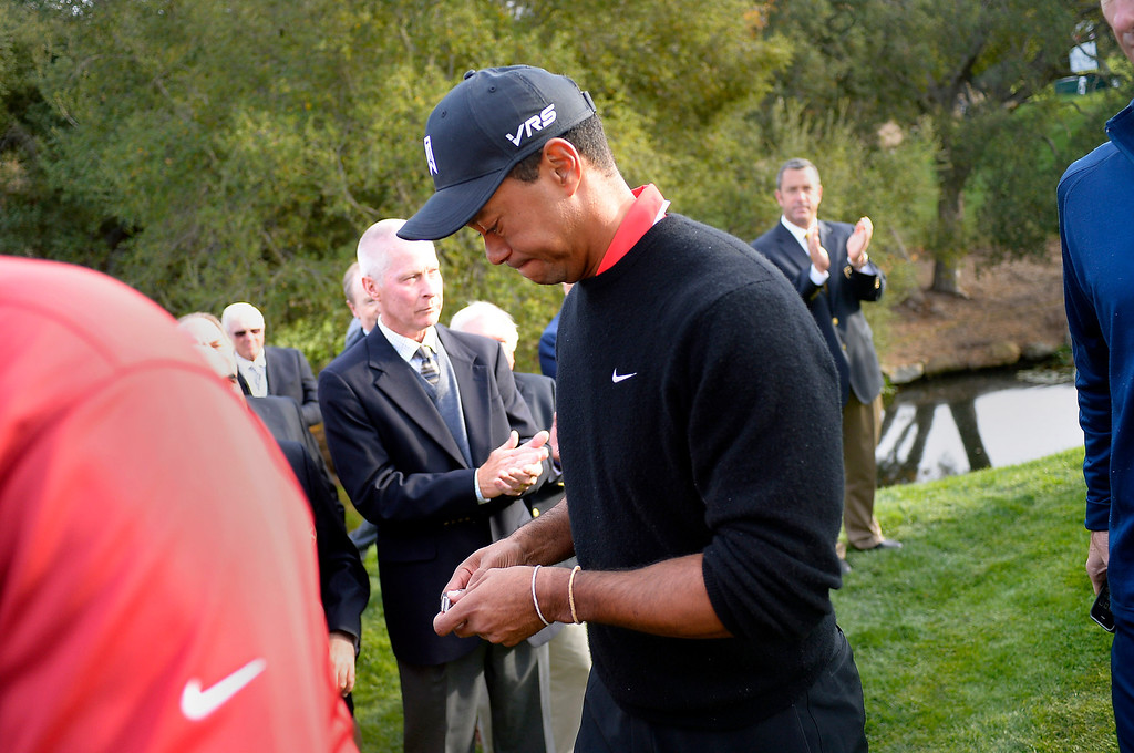 . Tiger Woods makes his way to the clubhouse after losing to Zach Johnson in the final round of the Northwestern Mutual World Challenge golf tournament at Sherwood Country Club, Sunday December 8, 2013, in Thousand Oaks, Calif.(Andy Holzman/Los Angeles Daily News)