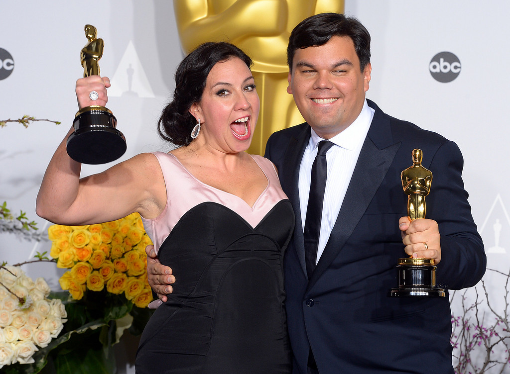 ". Kristen Anderson-Lopez and Robert Lopez accept the Oscar for ""Original Song\"" for the film Frozen,  backstage at the 86th Academy Awards at the Dolby Theatre in Hollywood, California on Sunday March 2, 2014 (Photo by David Crane / Los Angeles Daily News)"