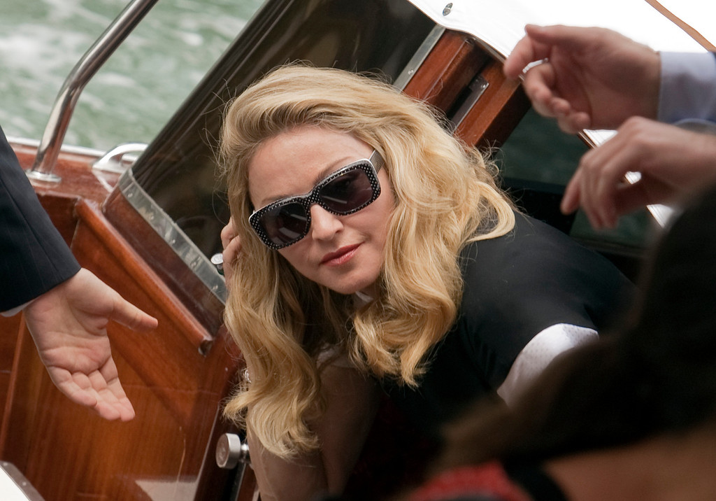 . Singer Madonna arrives in a boat for the press conference of her movie W.E. at the 68th edition of the Venice Film Festival in Venice, Italy, Thursday, Sept. 1, 2011. (AP Photo/Domenico Stinellis)