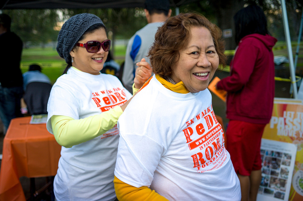 . Cynthia Cruz of Altadena places a entrant number on the back pot Leah Cruz of Azuza for a 5K Walk for hurricane disaster relief at Balboa Park in Van Nuys, CA Sunday, November 10, 2013.  The ROMAH Foundation, Inc. in partnership with Philippine Disaster Relief Organization held a walk and fundraiser for disaster relief in the Philippines.   ( Photo by David Crane/Los Angeles Daily News )
