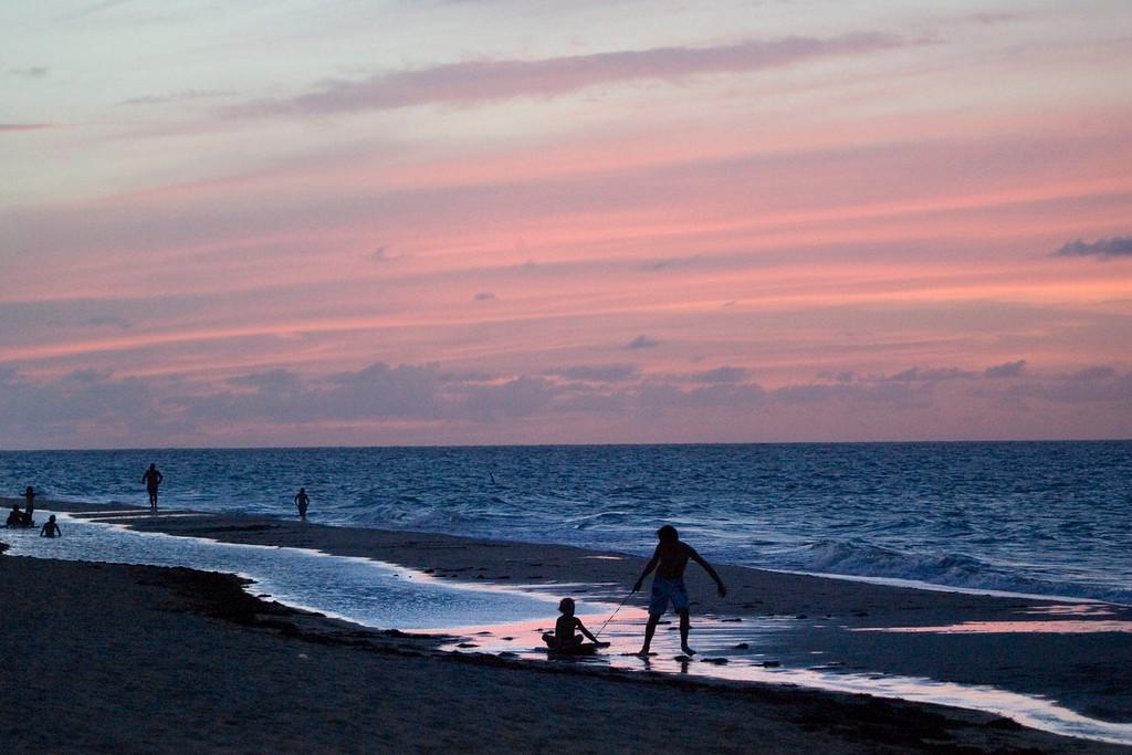 . Children play on a beach in San Juan, Thursday, June 12, 2008.  (AP Photo/Brennan Linsley)