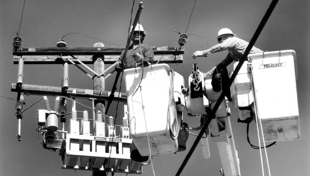 . June 28, 1992: Tony Chavez, left, and Skip Smith of Southern California Edison reposition power lines over the intersection of 10th Street West and Avenue H-12 in Lancaster, after Sunday morning\'s two powerful earthquakes shook the lines off their poles.  Daily News file photo