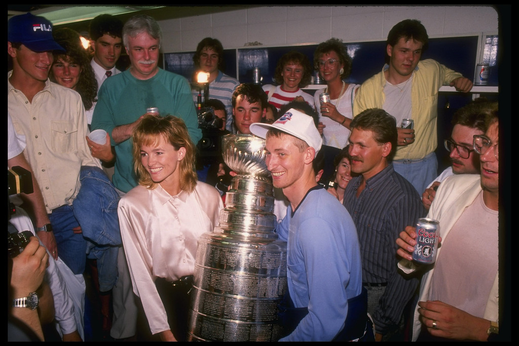 . 1988:  Center Wayne Gretzky of the Edmonton Oilers and his wife Janet pose with the Stanley Cup after sweeping the Boston Bruins 4-0. Mandatory Credit: Mike Powell  /Allsport