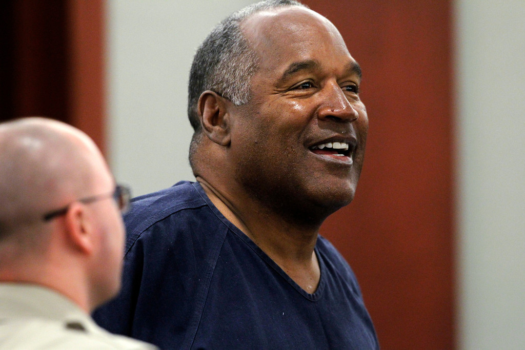 . O. J. Simpson listens to testimony during the second day of an evidentiary hearing for Simpson in Clark County District Court, Tuesday, May 14, 2013 in Las Vegas.  The hearing is aimed at proving Simpson\'s trial lawyer, Yale Galanter,  had conflicted interests and shouldn\'t have handled Simpson\'s case. Simpson is serving nine to 33 years in prison for his 2008 conviction in the armed robbery of two sports memorabilia dealers in a Las Vegas hotel room.  (AP Photo/Steve Marcus, Pool)