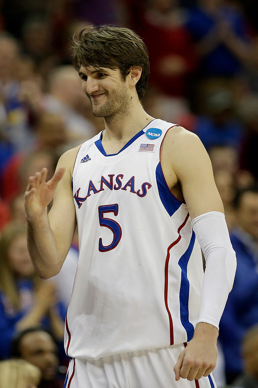. <b>Jeff Withey </b> <br />Center, 7-0, 235. Averaged 13.7 points, 8.5 rebounds and 3.9 blocks as a senior at Kansas. Size and athleticism make him a defensive stalwart. Still developing offensively. Could be a good option as a reliable backup to defend bigs. (AP Photo/Charlie Riedel)